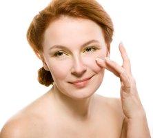 Application of rosehip oil. Skin care regime.